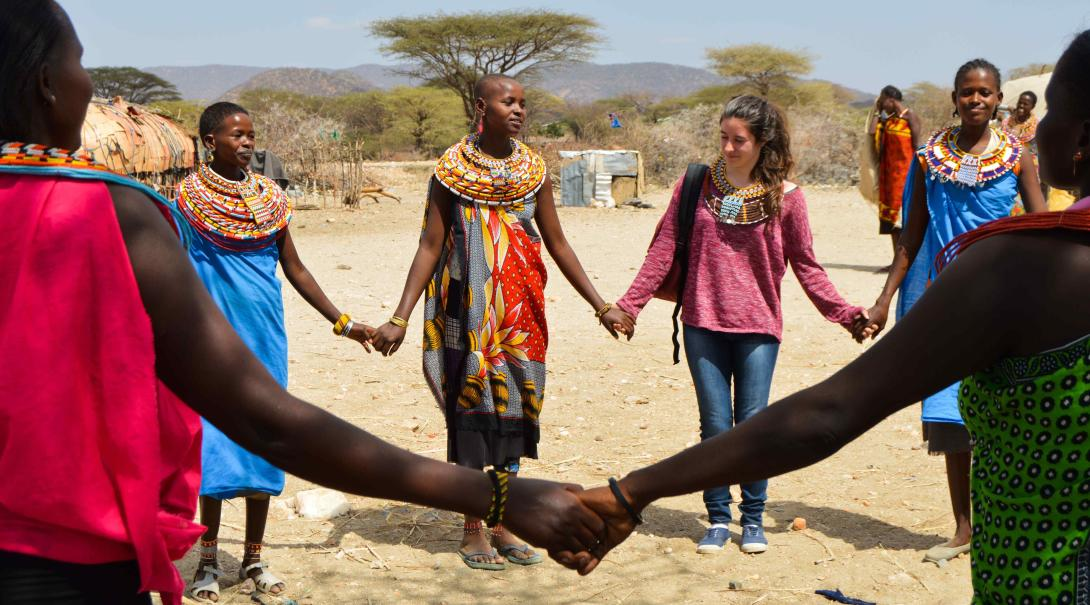 Projects Abroad volunteers learn a traditional dance in Kenya